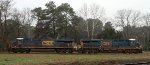 CSX 3064 & 863 sit in the wye on an overcast morning