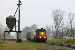 CSX 8147 leads a few cars southbound on a rainy morning