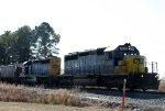 CSX 8818 leads an empty grain train northbound