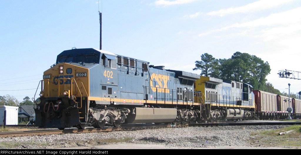 CSX 402 leads an empty coal train westbound across the diamonds