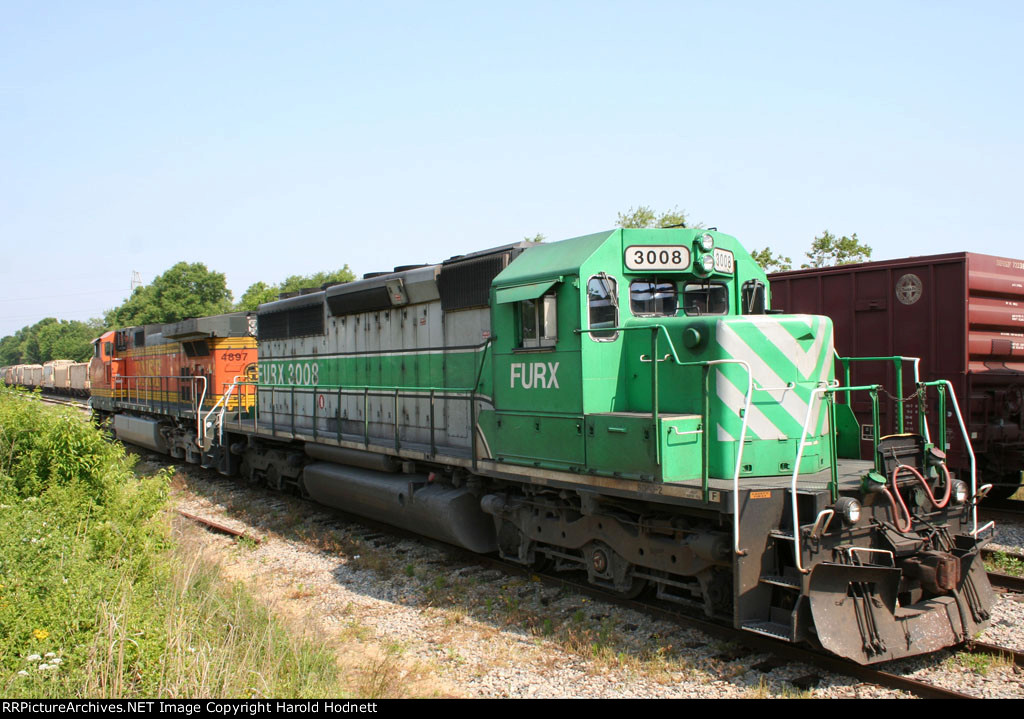 FURX 3008 & BNSF 4897 sit in a siding as a CSX train rolls by