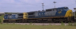 CSX 7907 & 7357 bring a train through town
