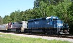 HLCX 8142 & BNSF 679 are tied down in the siding on a CSX train