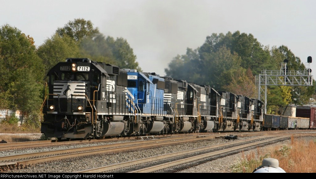 NS 7112 leads 6 other units westbound at D&S Jct.