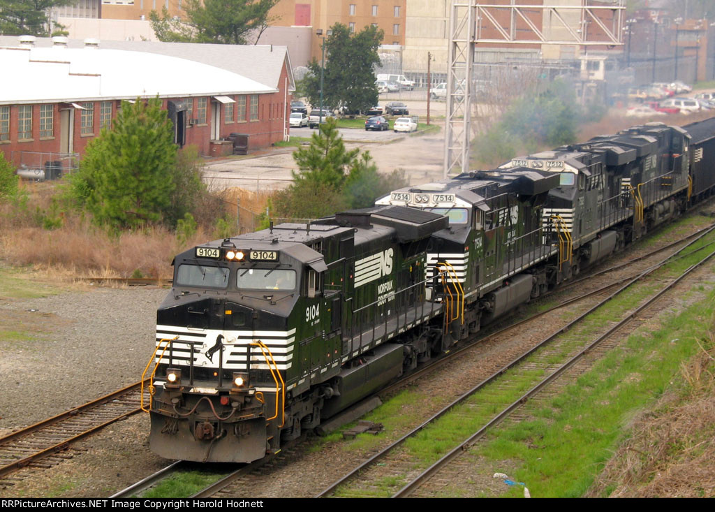 NS 9104 leads 3 other GE's on a loaded coal train