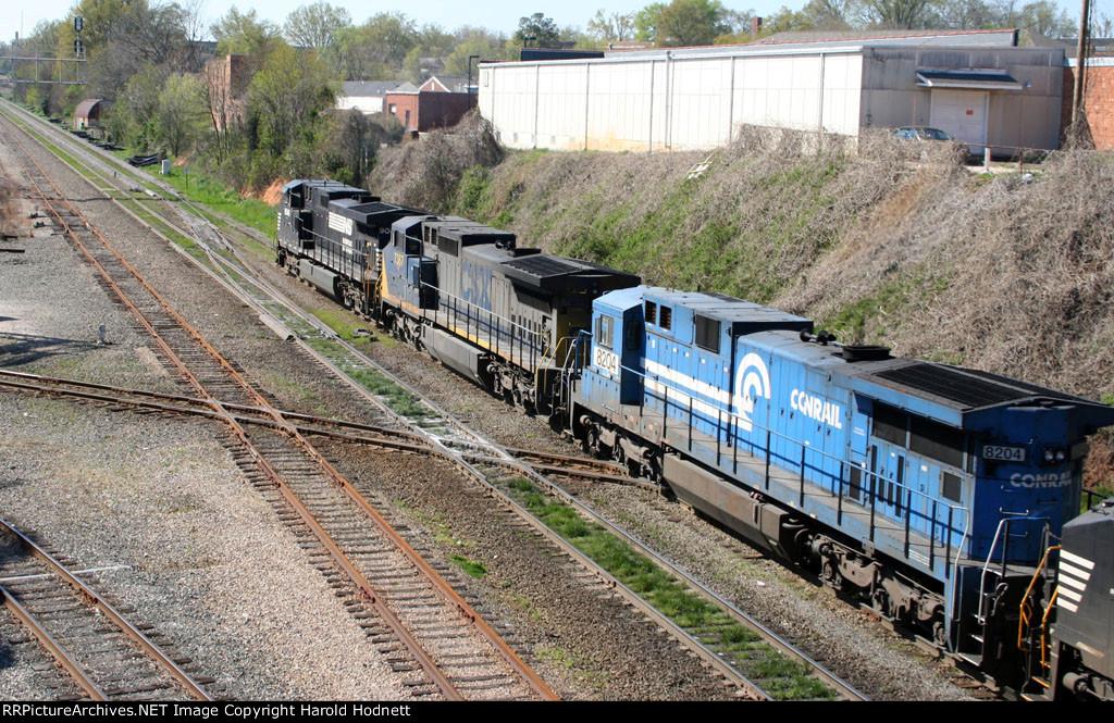 NS 9046 leads a variety of units across Boylan Jct