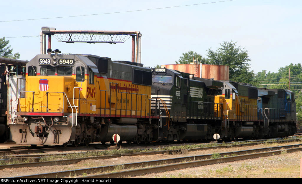 CRIX 5949, 5948 and 2 NS locos sit at the fuel racks