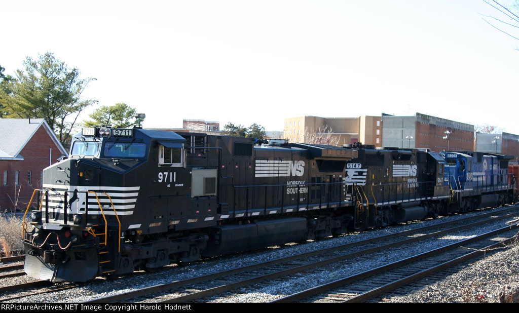 NS 9711, 5147, 8204 sit in the siding beside Central Prison
