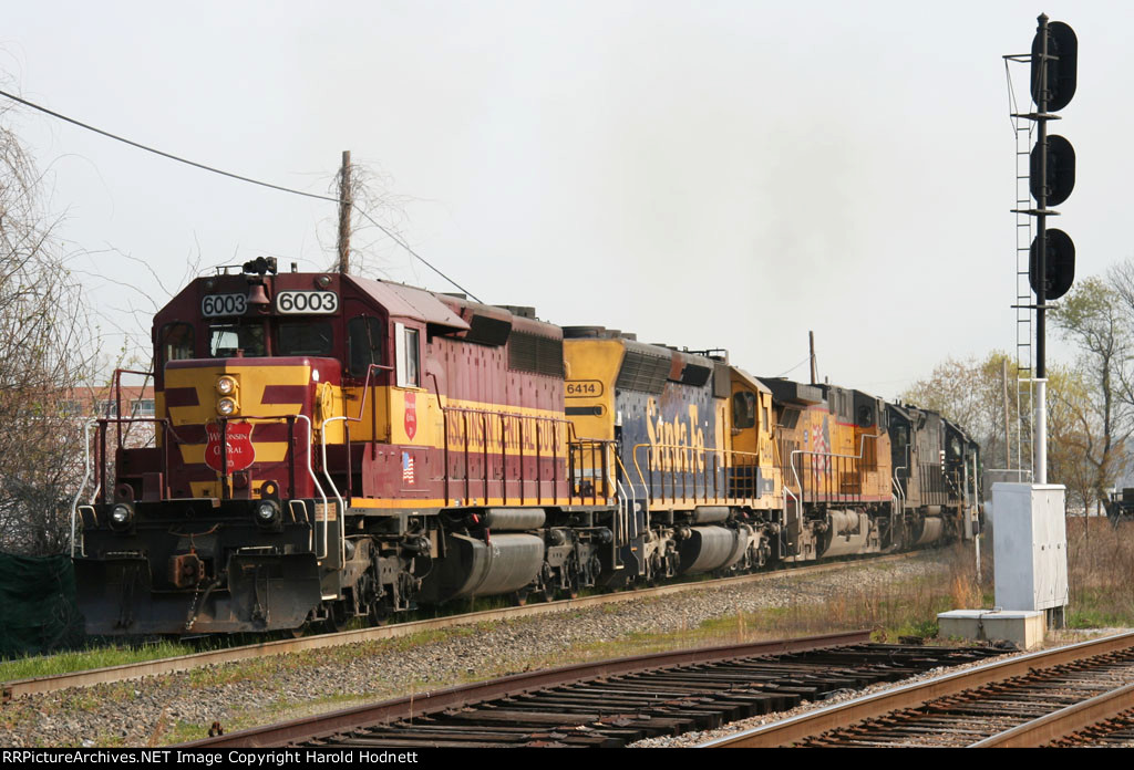 WC 6003 leads an assortment of locos on NS train 349
