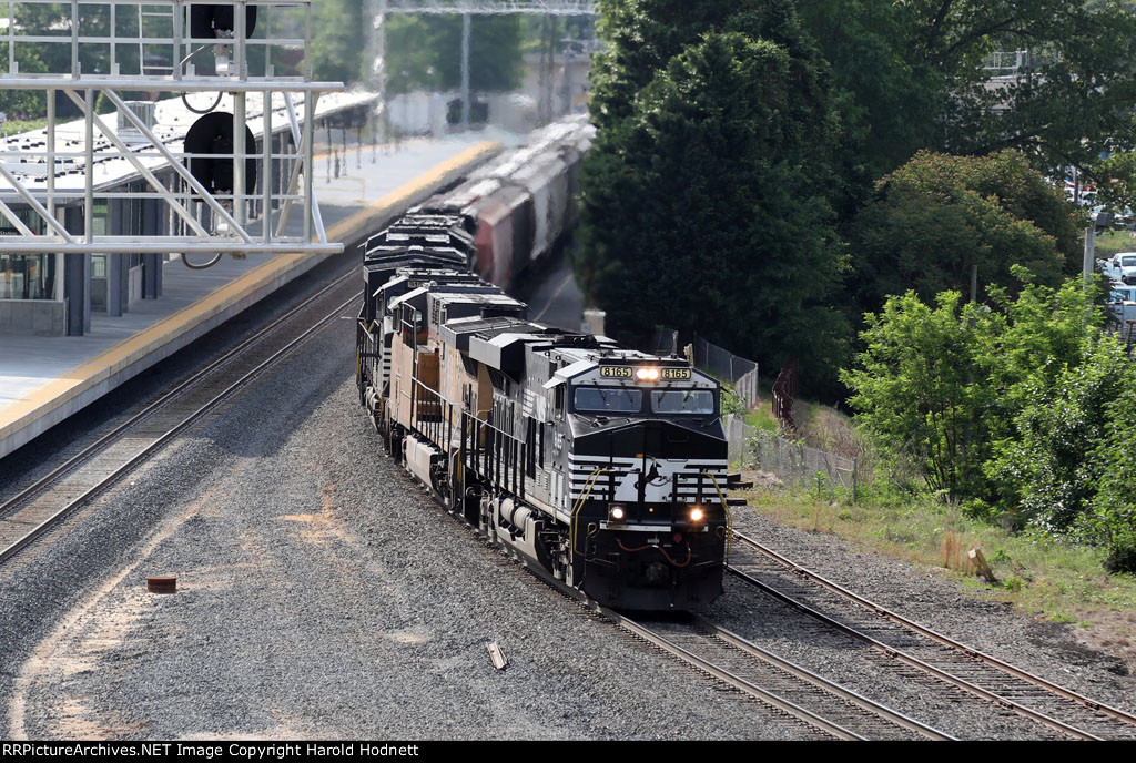 NS 8165 leads train 60U past the new station