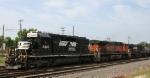 NS 3443 leads train 350 thru town