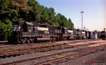 NS 7011, 5077, and 2768 sit with other locos near the fuel rack