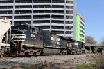 NS 9464 & 9726 lead train E25 past new construction in downtown