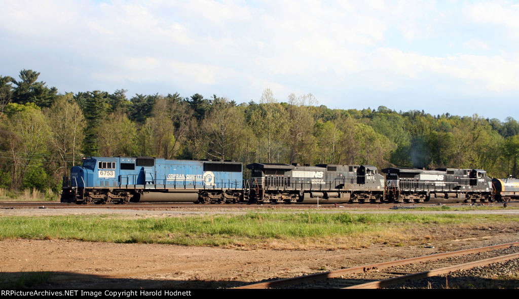 NS 6753 and two GE units lead a train east late in the afternoon