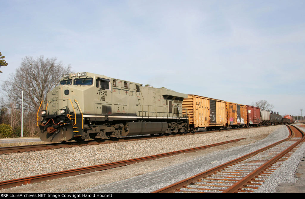 NS 7520 leads a short train westbound