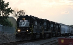 NS 7018 leads train P60 eastbound at dusk before it rains