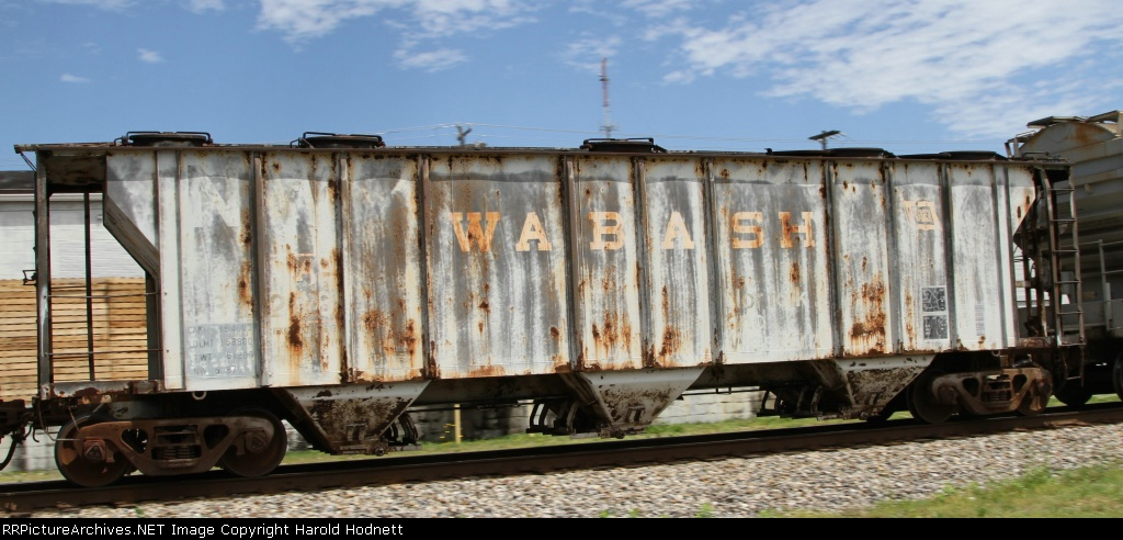 An old covered hopper with Wabash markings clearly showing through