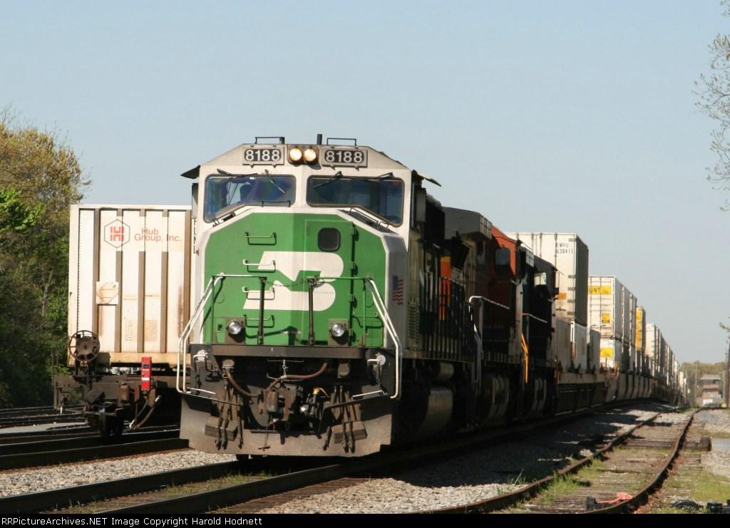 BNSF 8188 leads NS train 214 past train 213