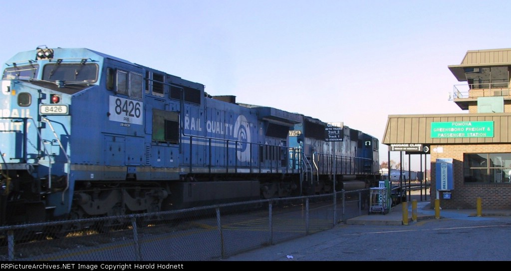 NS 6754 & 8426 head southbound past Pomona Tower