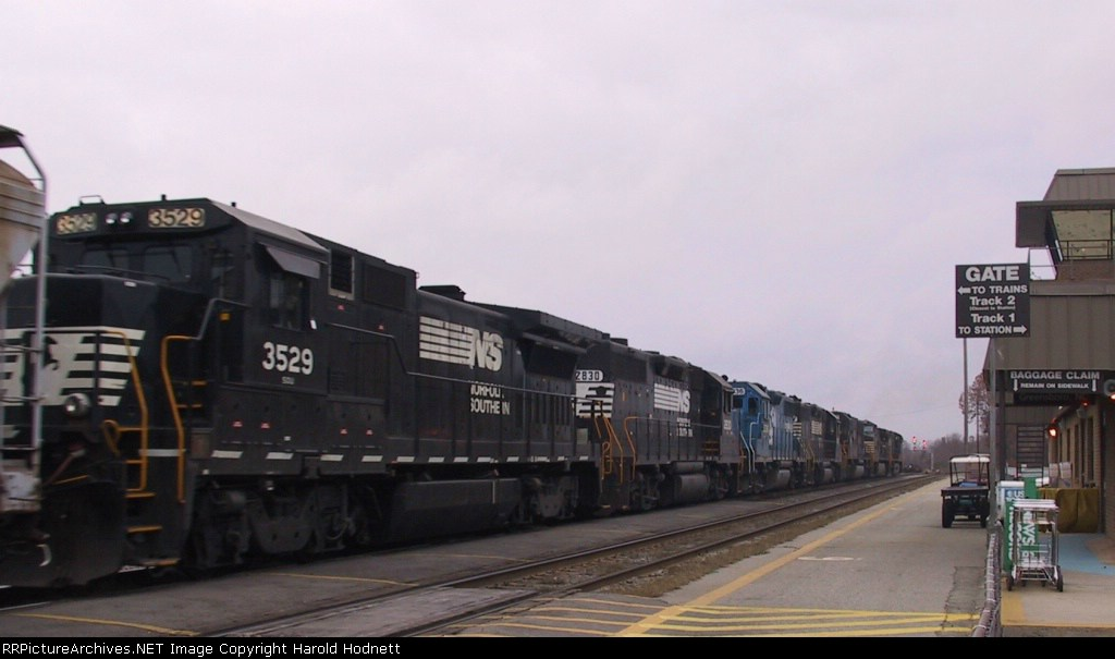 NS 3529 is the last of 7 locos on a southbound train passing Pomona Tower