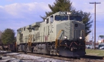 NS 9707 & 9716 (both in primer) lead an intermodal train northbound