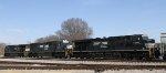 NS 2557 & 7601 roll through town with an empty grain train