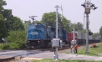 NS 6772 leads an intermodal train northbound through town