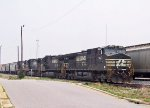 NS 9127 & 3 other GE's lead a grain train south at Pomona