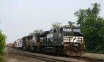 NS 9565 leads a train onto the yard lead