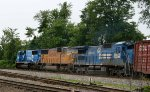A pair of Conrail blue NS locos bracket a UP loco a southbound train