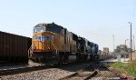 UP 4683 leads NS train 214 northbound past Pomona Tower