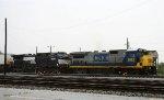 CSX 5953 leads NS train 218 through the yard