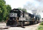 NS 2567 leads a grain train down the yard lead