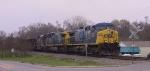 CSX 352 leads a train through town
