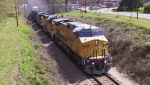 UP 9717 leads a CSX train westbound