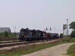 NCYR 8330 leads a train making a pickup