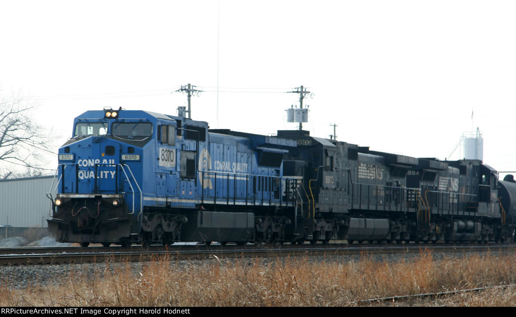 NS 8370 leads two standard cab GE's and a train northbound