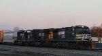 NS 9102 leads train 348 through town as the sun is setting