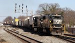 NS 2514 leads a long train 213 past the signals at 11th Street