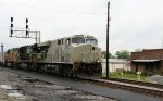 NS 7557, still in primer, leads a southbound train past the station