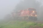 CP 8764 rolls by in the thick morning fog