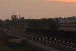 Coal train heads out into the sunset