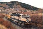 Loaded coal train sweeps around the curve