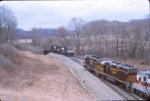 A pair of NS helpers drift south past an OC coal train waiting to head north at Glouster