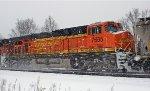 BNSF 7695 on NS 65T