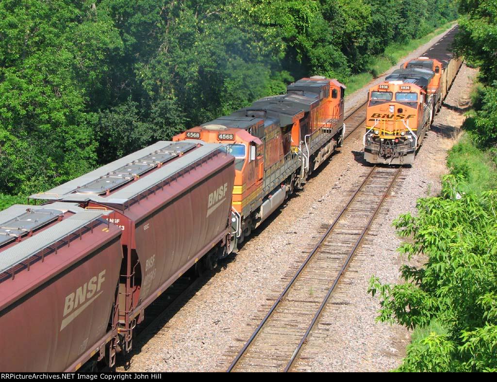 110718007 Westbound BNSF Grain Train Meets Eastbound Coal Train (COLX)
