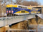 110109001 Inbound Northstar MNRX Commuter Train Crosses Mississippi River East Channel To Nicollet Island