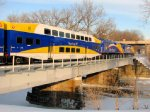 110109002 Inbound Northstar MNRX Commuter Train Crosses Mississippi River East Channel To Nicollet Island