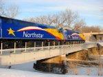 110109003 Inbound Northstar MNRX Commuter Train Crosses Mississippi River East Channel To Nicollet Island