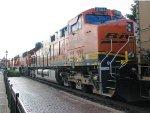 110712047 Westbound BNSF coal empties pass ex-GN Wayzata Depot